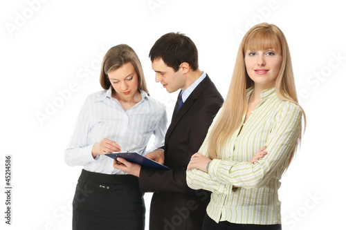 Portrait of business people, focus on a businesswoman