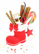 Sweet Christmas. Santa Claus boot stuffed with candies