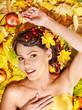 Woman holding autumn fruit.