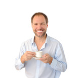 Smiling man drinking coffee isolated on white background