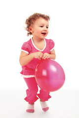 a little cute girl with a balloon