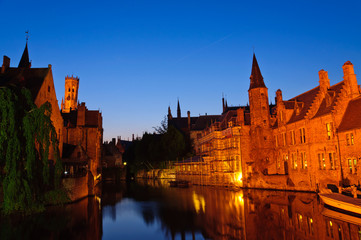 View from the Rozenhoedkaai at the Old Town of Bruges at dusk