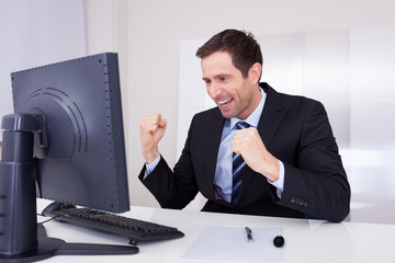 Portrait Of Happy Businessman Cheering