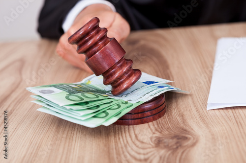 Male Judge Striking The Gavel On Euro Note