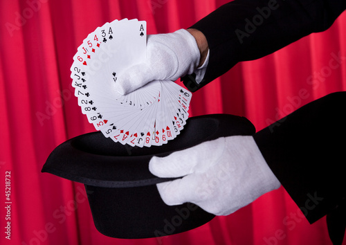 Magician Hand Holding Fanned Deck Of Cards