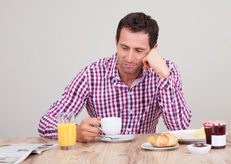 Portrait Of Young Man Having Breakfast