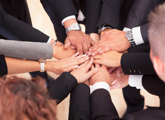 Business People With Their Hands Together