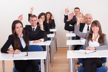 Businesspeople Raising Their Hands