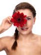 Beautiful girl with clean skin and flower closeup - isolated