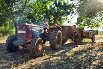 Farmers family with tractor