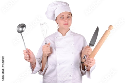 serious young female chef with four hands, isolated on white