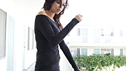 Sexy fashion model on balcony flirting