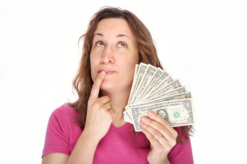 Young thoughtfully woman with money in hand