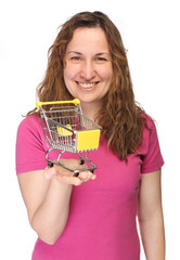 Young cheerful woman with mini shopping cart