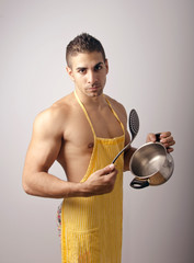 Sexy Young man in the kitchen