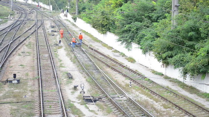 Workers of railway measure the parameters of track