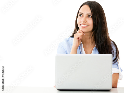 Pensive woman with a laptop