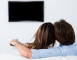 Couple watching tv at home