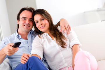 Couple holding a remote control