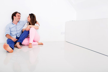 Couple in their empty apartment