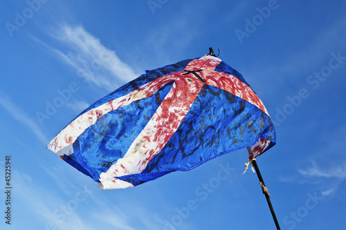 Blood stained torn scottish flag