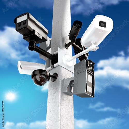Surveillance mega camera's concept with a sky background