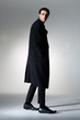 Full length a young fashion male walking