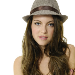 Close up vogue style photo of fashion model with hat