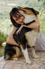 Woman with australian shepherd dog