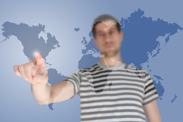 Casual young man touching world map screen