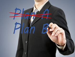 businessman hand drawing plan a plan b