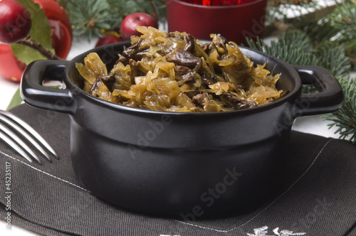 traditional polish sauerkraut (bigos) with mushrooms and plums
