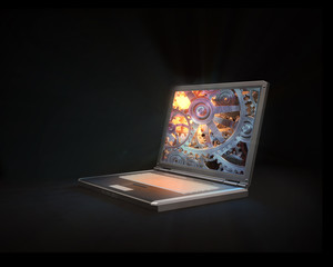 Open laptop with a gear and cog wheel screen