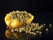 Half yellow bell pepper full of peas.