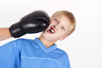 Hitting with boxing glove. Isolated on the white