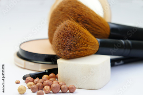 Makeup foundation, powder, bronzer and brushes