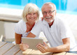 canvas print picture - Different aged couple using a tablet pc outside