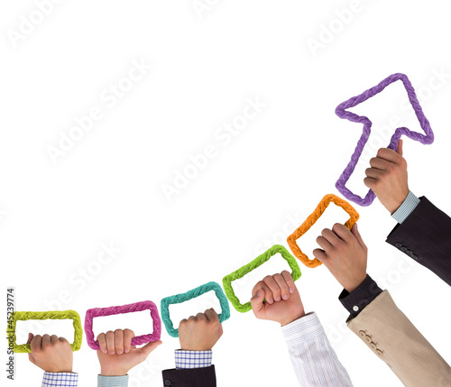 Hands holding colorful rope forming arrow pointing upwards