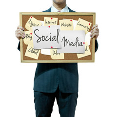 Business man holding board on the background, Social Media conce