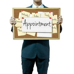 Business man holding board on the background, Appointment