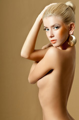 beautiful blonde in gold earrings