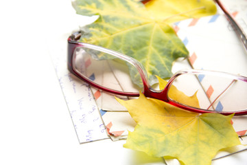 Old envelopes and autumn leaves