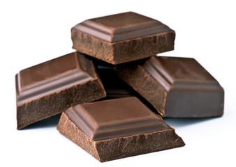 black chocolate chunks, arranged on white base
