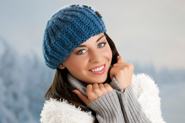 Winter smiling young woman