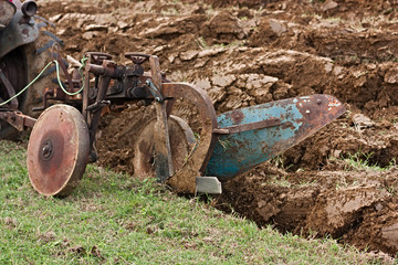 plowing with an old plow