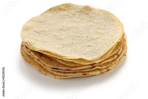 a stack of corn tortillas, mexican food