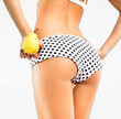 Woman perfect slim body holding a pear.