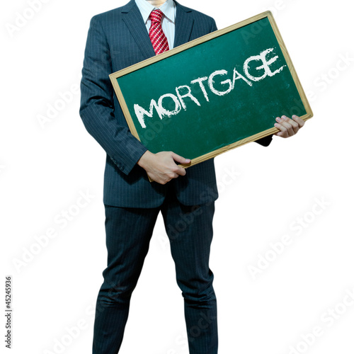 Business man holding board on the background with business word