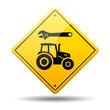 Señal amarilla reparacion tractor