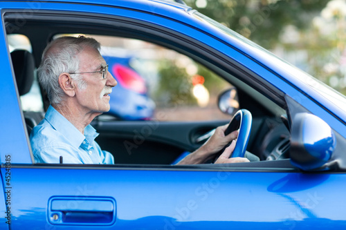 Elder man driving a car